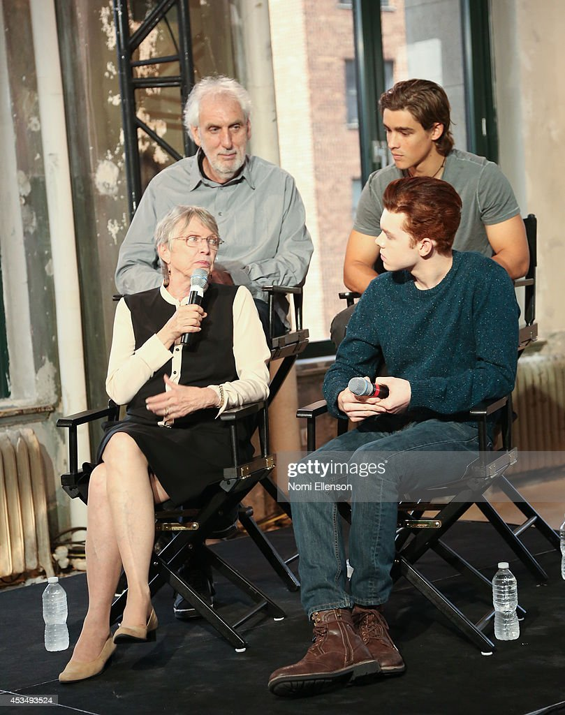 Author Louis Lowry, actor Cameron Monaghan director Phillip Noyce, and actor Brenton Thwaites attend AOL's Build Speaker Series Presents: 'The Giver' Author, Director & Cast at AOL Studios In New York on August 11, 2014 in New York City.