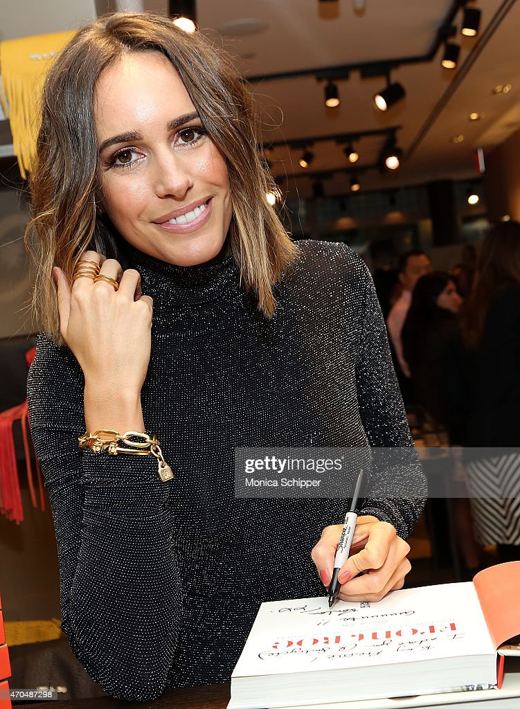 Author Louise Roe signs copies of her book at The Launch Of Louise Roe's Book Front Roe How To Be the Leading Lady In Your Own Life Hosted By UNOde50...