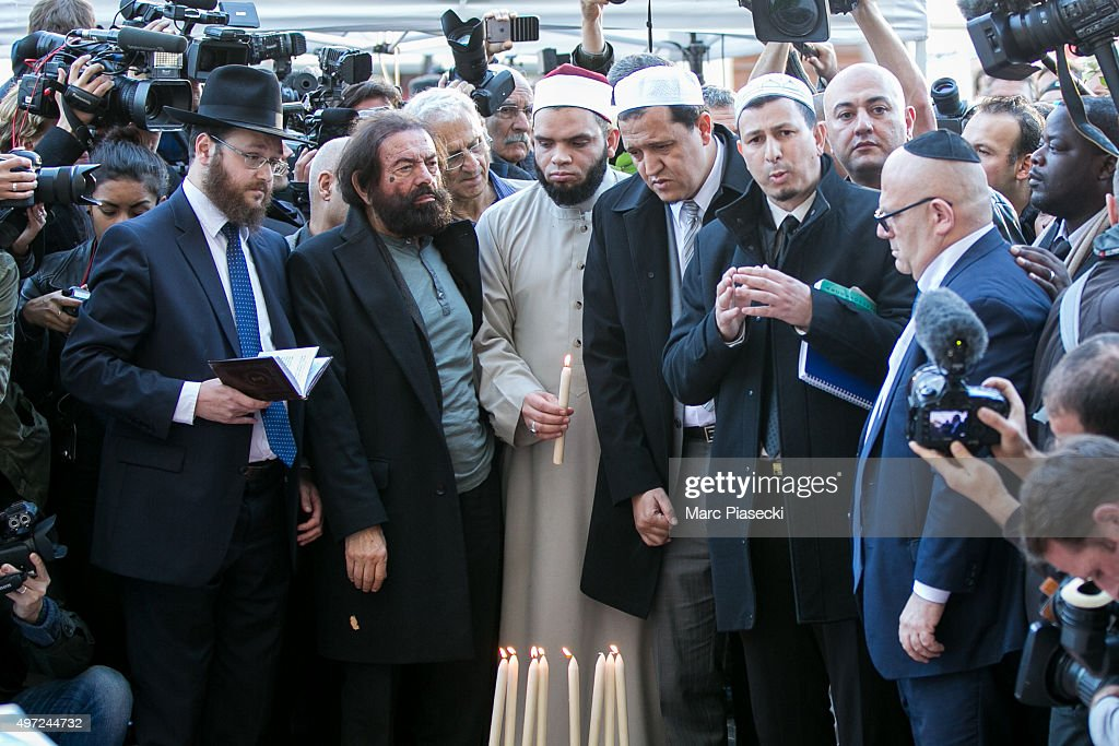 Author <a gi-track='captionPersonalityLinkClicked' href=/galleries/search?phrase=Marek+Halter&family=editorial&specificpeople=768328 ng-click='$event.stopPropagation()'>Marek Halter</a> (2nd from L), Imam of the Drancy Mosque, Hassen Chalghoumi (4th from L), Imam of one of the Nimes Mosques, Hocine Drouiche (2nd from R) and representative of the Jewish community gather at a makeshift memorial near the 'Bataclan' theatre in Paris on November 15, 2015 on November 15, 2015 in Paris, France. As France observes three days of national mourning members of the public continue to pay tribute to the victims of Friday's deadly attacks. A special service for the families of the victims and survivors is to be held at Paris's Notre Dame Cathedral later on Sunday.