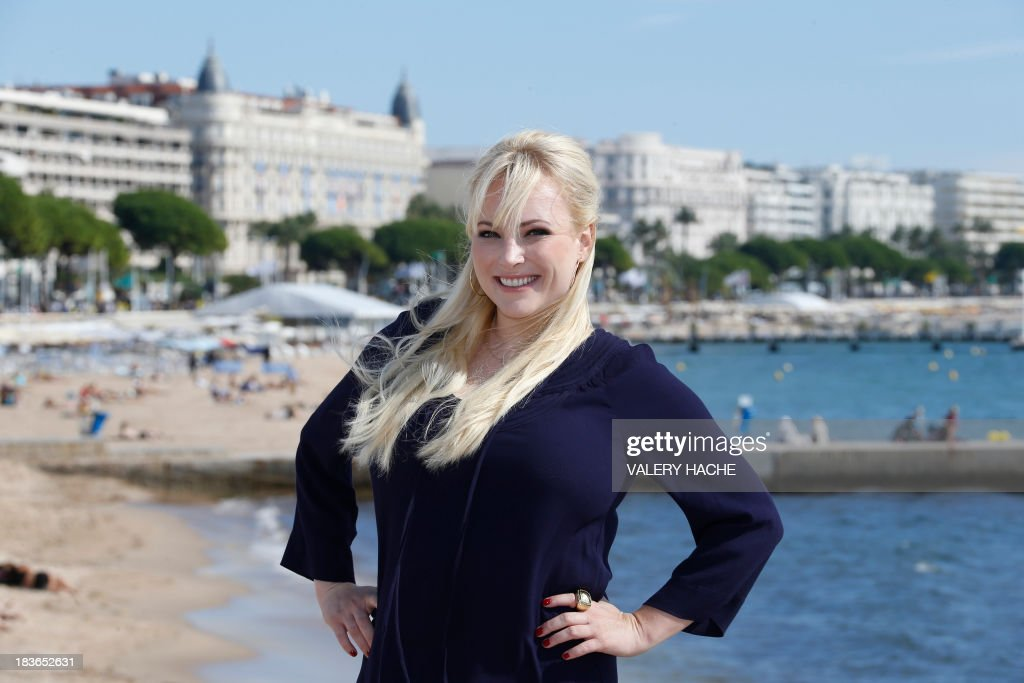 US author Meghan Mccain poses during a photocall for a TV show 'Raising Mccain' as part of the MIPCOM audiovisual trade fair on October 8, 2013 in Cannes, southeastern France.