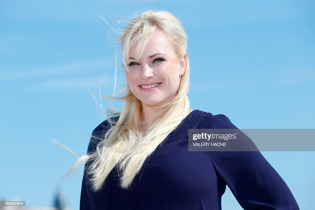 US author Meghan Mccain poses during a photocall for a TV show 'Raising Mccain' as part of the MIPCOM audiovisual trade fair on October 8, 2013 in Cannes, southeastern France. AFP PHOTO / VALERY HACHE