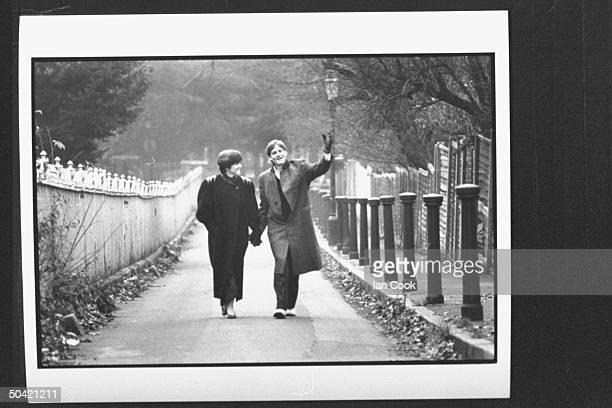Author Michael Lewis walking w his wife Diane through a park