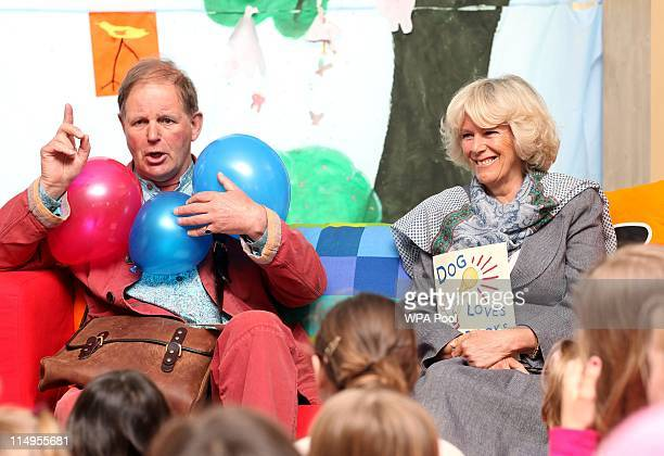 Author Michael Morpurgo and Camilla Duchess of Cornwall read stories to children in the Hay Fever area at Hay Literary Festival on May 31 2011 in...
