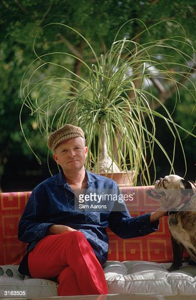 Author of 'Breakfast at Tiffany's' Truman Capote and his dog in Palm Springs California