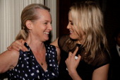 Author of 'Orange is the New Black' and the Women's Prison Association Board Vice President Piper Kerman and actress Taylor Schilling attend the 2013...