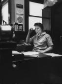 Author of To Kill a Mockingbird Harper Lee in her father's law office while visting her home town