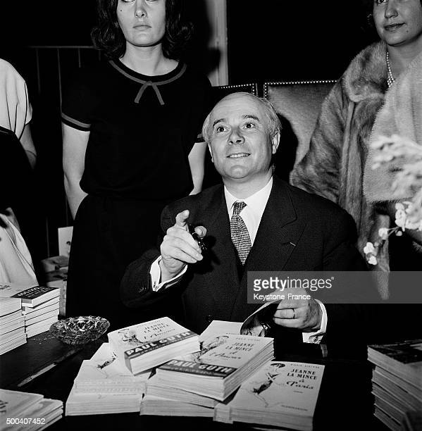 Author Paul Guth presents his book 'Jeanne la mince a Paris' at a book signing in September 1962 in Paris France