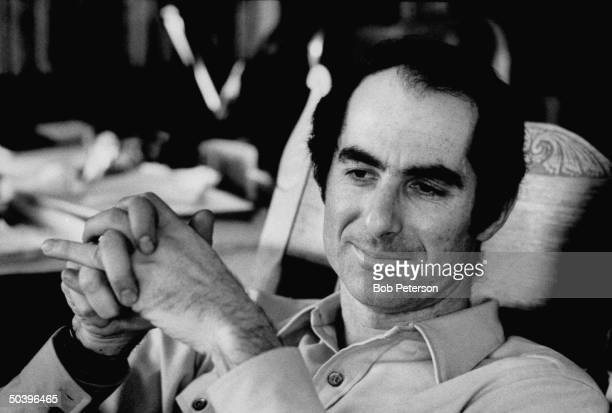 Author Philip Roth drinking a glass of beer as he pauses during work on manuscript