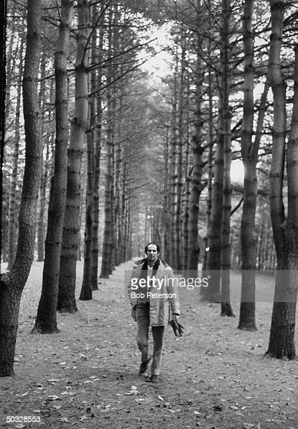 Author Philip Roth walking in woods in area where he grew up