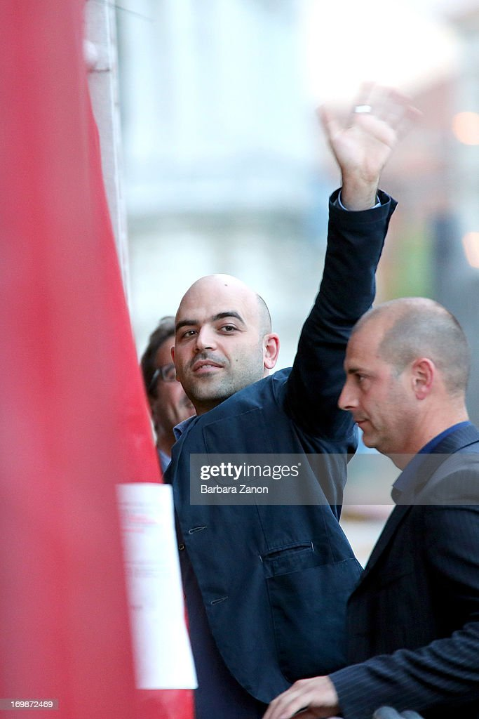 Author <a gi-track='captionPersonalityLinkClicked' href=/galleries/search?phrase=Roberto+Saviano&family=editorial&specificpeople=3964077 ng-click='$event.stopPropagation()'>Roberto Saviano</a> arrives in Venice to present latest book 'ZeroZeroZero' at La Toletta bookshop at La Pescheria di Rialto on June 3, 2013 in Venice, Italy. Italian author and journalist Saviano lives under police escort since 2006, after the publication of his book 'Gomorrah'.