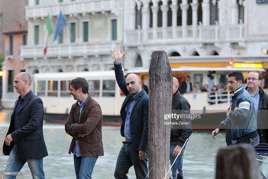 Author Roberto Saviano arrives in Venice to present latest book 'ZeroZeroZero' at La Toletta bookshop at La Pescheria di Rialto on June 3, 2013 in Venice, Italy. Italian author and journalist Saviano lives under police escort since 2006, after the publication of his book 'Gomorrah'.