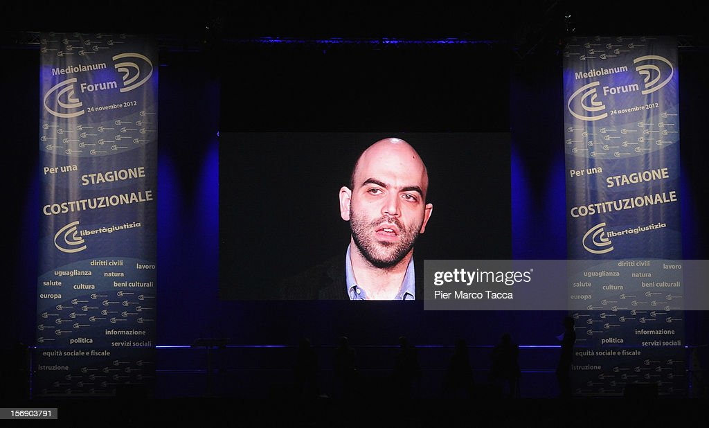 Author <a gi-track='captionPersonalityLinkClicked' href=/galleries/search?phrase=Roberto+Saviano&family=editorial&specificpeople=3964077 ng-click='$event.stopPropagation()'>Roberto Saviano</a> is projected on a large screen during his speech at 'Liberta e Giustizia' Meeting on November 24, 2012 in Milan, Italy. Cultural association Liberta e Giustizia (Freedom and Justice) was founded in 2002 by well-known cultural figures and aims to 'be the missing link between the best ferment of society and the official space policy'.
