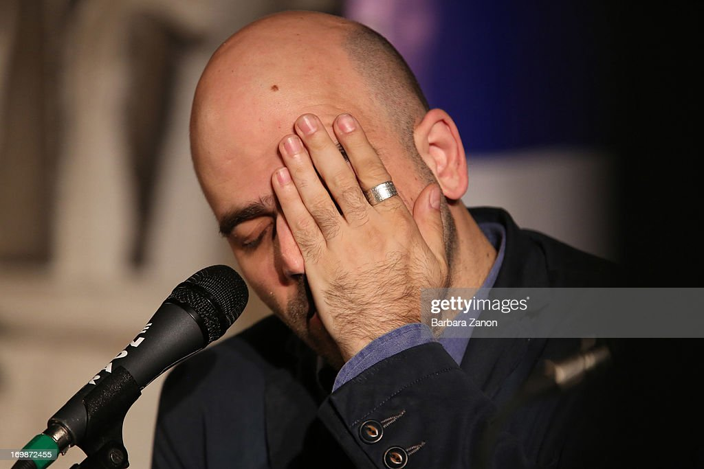 Author <a gi-track='captionPersonalityLinkClicked' href=/galleries/search?phrase=Roberto+Saviano&family=editorial&specificpeople=3964077 ng-click='$event.stopPropagation()'>Roberto Saviano</a> presents the book 'ZeroZeroZero' at La Toletta bookshop at La Pescheria di Rialto on June 3, 2013 in Venice, Italy. Italian author and journalist Saviano lives under police escort since 2006, after the publication of his book 'Gomorrah'.