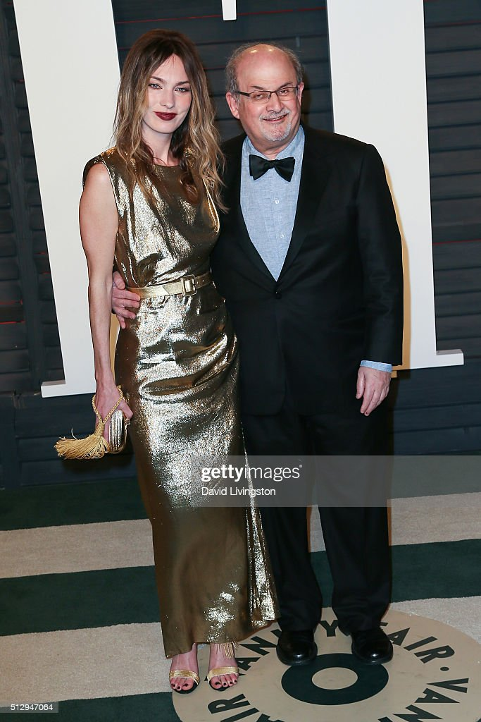 Author Salman Rushdie and guest arrive at the 2016 Vanity Fair Oscar Party Hosted by Graydon Carter at the Wallis Annenberg Center for the Performing Arts on February 28, 2016 in Beverly Hills, California.