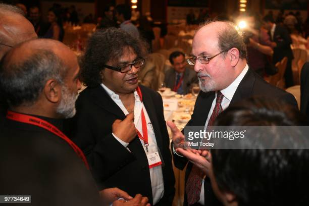 Author Salman Rushdie has a word with other guests at the dinner party hosted after the India Today Conclave ended in New Delhi on March 13 2010