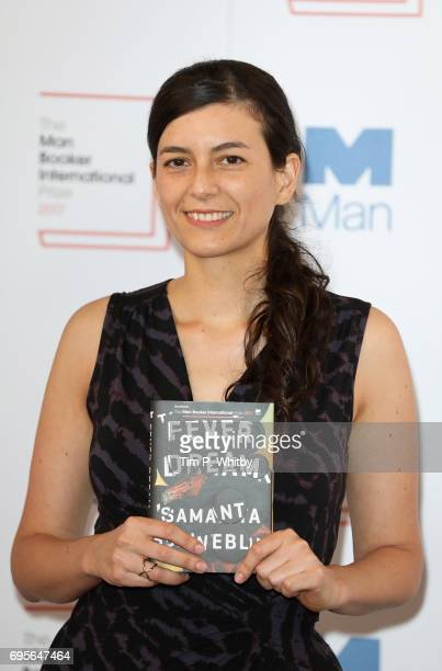 Author Samanta Schweblin of Argentina with the book 'Fever Dream' at a photocall for the shortlisted authors and translators for the Man Booker...