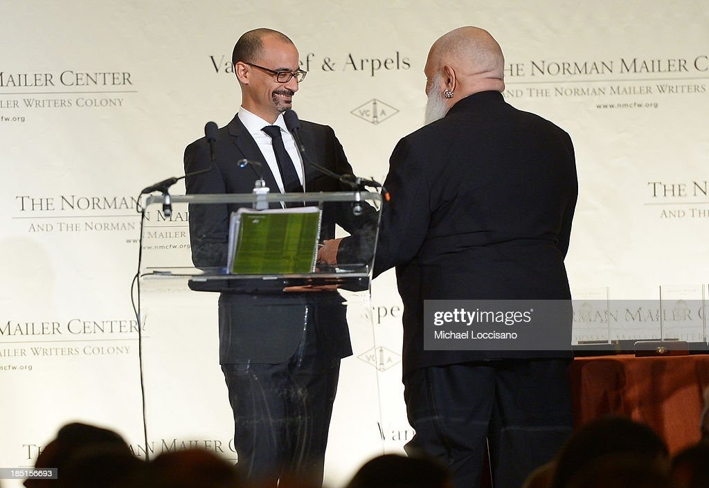 Author Samuel R. Delany (R) presents Junot Diaz with an award at the Norman Mailer Center's Fifth Annual Benefit Gala sponsored by Van Cleef & Arpels at the New York Public Library on October 17, 2013 in New York City.