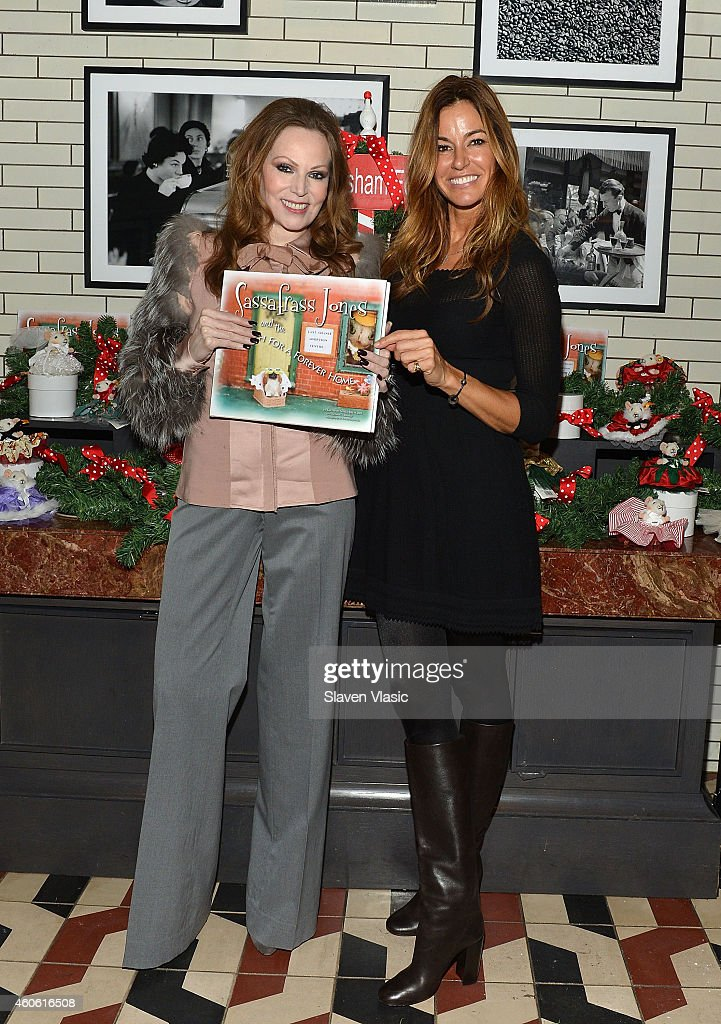 Author Sassafrass Jones and model/TV personality Kelly Bensimon toast the Humane Society of New York with holiday yappy hour hosted by Sant Ambroeus...