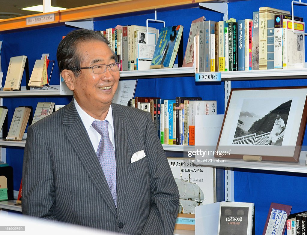 Author Shintaro Ishihara smiles surounded by his books and picture as his collection launch at Zushi Library on July 8, 2014 in Zushi, kanagawa, Japan.