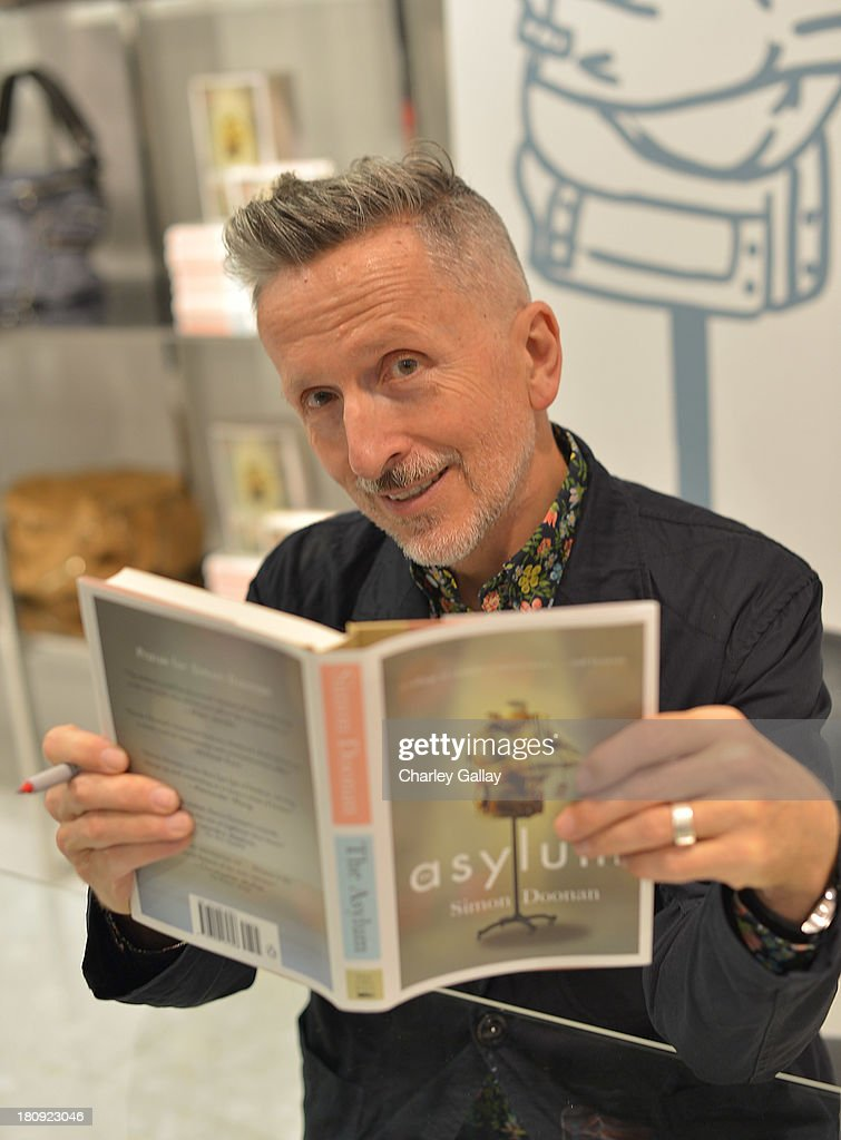 Author Simon Doonan attends Barneys New York Cocktail Event with Simon Doonan and 'Man Repeller' Leandra Medine celebrating their new books at Barneys New York At The Grove on September 17, 2013 in Los Angeles, California.