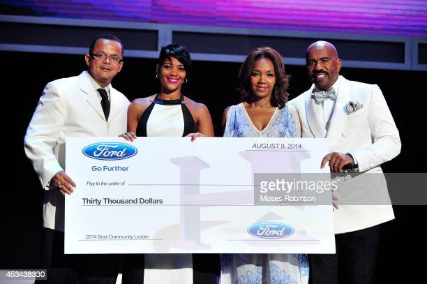 Author Stan Richards and Chereace Richards accept an award for Best Community Leader from Shawn Thompson and Steve Harvey at the 2014 Ford...