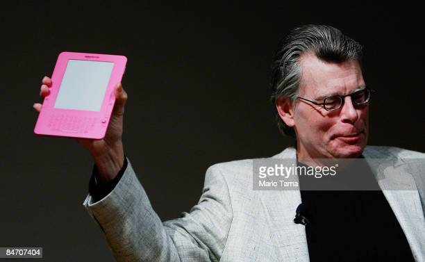 Author Stephen King holds a special pink Kindle given to him by Amazoncom founder and CEO Jeffrey P Bezos at an unveiling event for the Amazon Kindle...