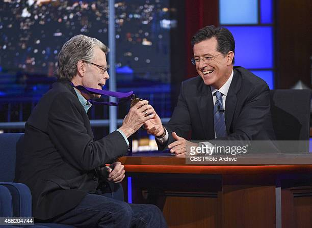Author Stephen King shows off his National Medal of Arts on the Late Show with Stephen Colbert Friday Sept 11 2015 on the CBS Television Network