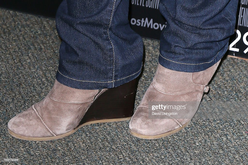 Author Stephenie Meyer (shoe detail) attends a signing for her book 'The Host' at Barnes & Noble bookstore at The Grove on March 15, 2013 in Los Angeles, California.
