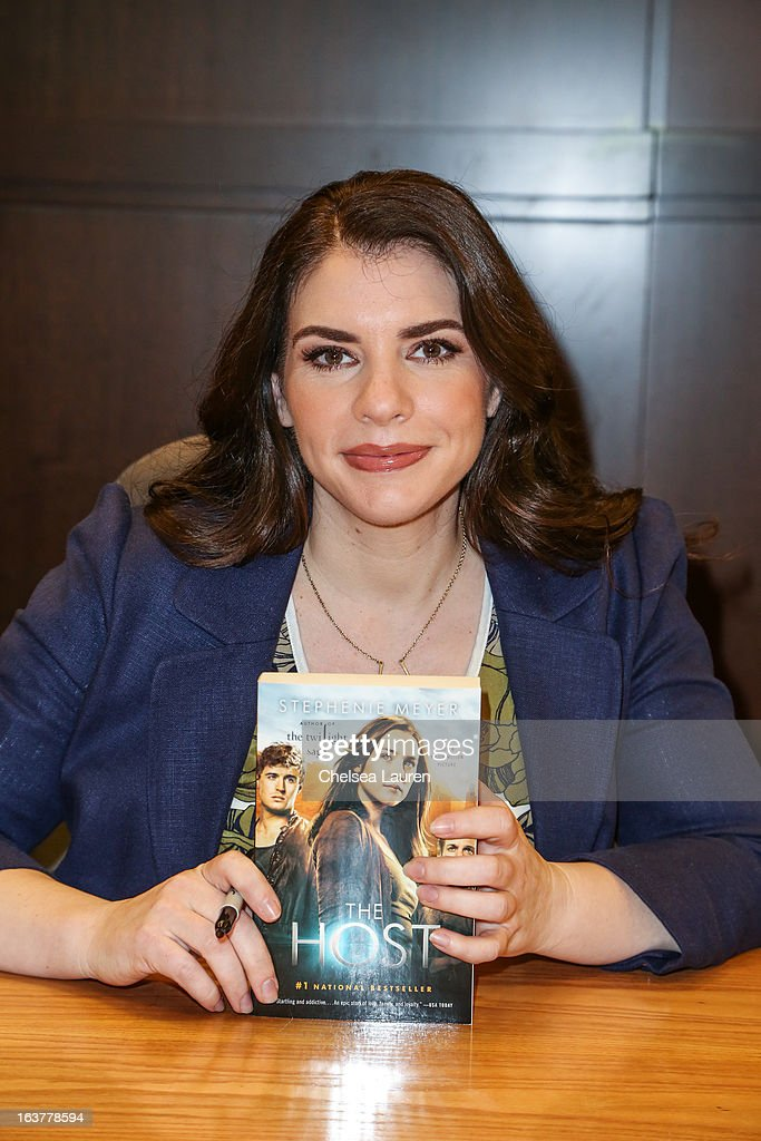Author Stephenie Meyer signs copies of her book 'The Host' at the celebration of the film release of 'The Host' at Barnes & Noble bookstore at The Grove on March 15, 2013 in Los Angeles, California.