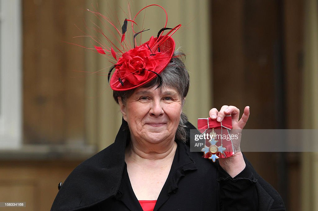 Author Susan Hill poses with her Commander of the British Empire (CBE) medal following an Investiture ceremony at Buckingham Palace in central London on December 13, 2012.