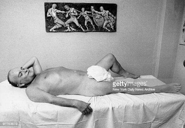 Author Truman Capote waits for a rubdown after a relaxing whirlpool bath at the gym