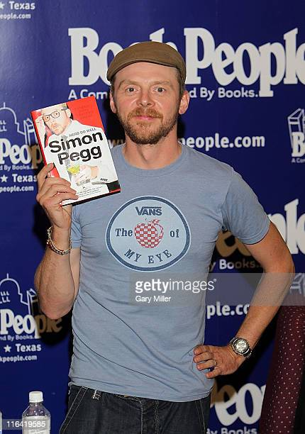 Author/actor Simon Pegg poses with his book before signing copies of 'Nerd Do Well' at Book People on June 15 2011 in Austin Texas
