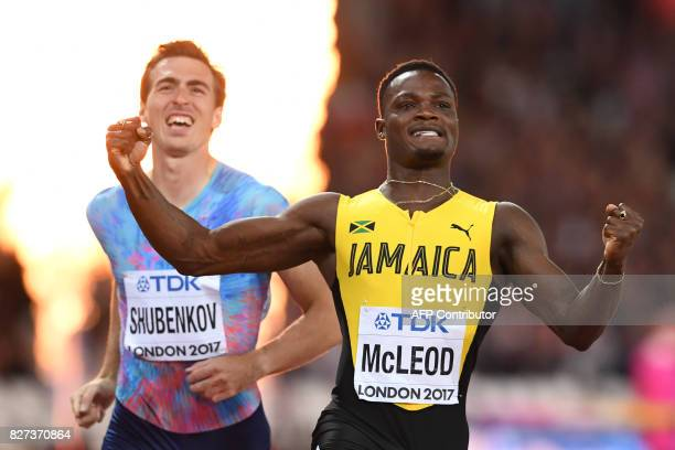 Authorised Neutral Athlete Sergey Shubenkov reacts to his second place as Jamaica's Omar Mcleod celebrates winning the final of the men's 110m...