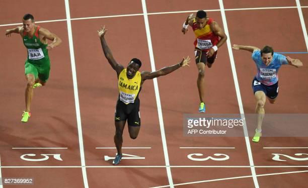 TOPSHOT Authorised Neutral Athlete Sergey Shubenkov Spain's Orlando Ortega Jamaica's Omar Mcleod Hungary's Balázs Baji cross the finish line in the...