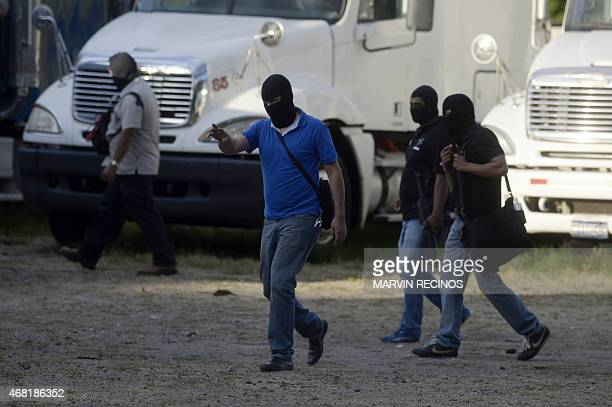 Authorities guard the crime scene after eight people were shot dead in Quezaltepeque some 25 km from San Salvador on March 30 2015 Gang violence in...