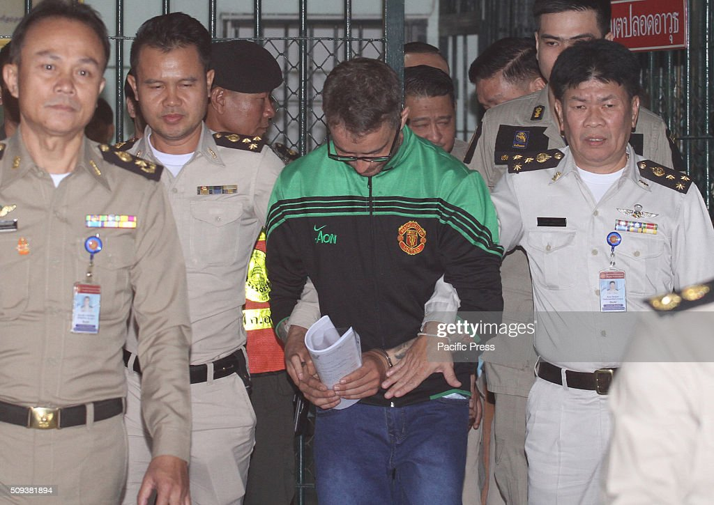Authorities lead Mr. Artur Segarra (Wearing Green Jacket) to jail after the Criminal Court where he denied the lawsuit allegations as the prime suspect in the grisly murder and dismemberment of a Spanish national.