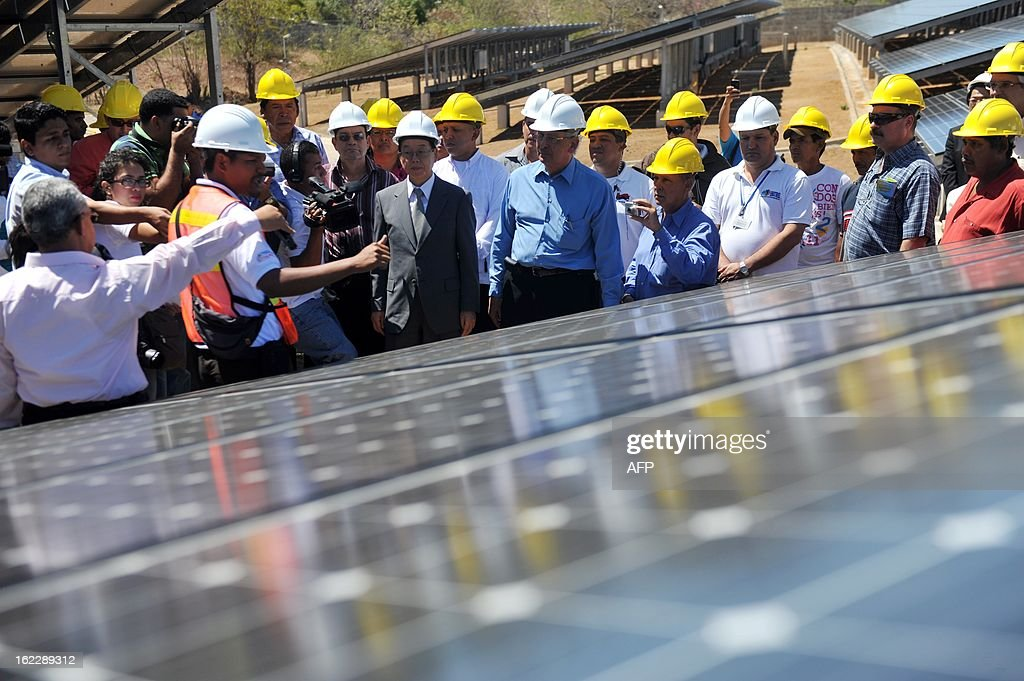Authorities tour the facilities during the inauguration of a photovoltaic power plant in Diriamba, 42 km from Managua on February 21, 2013. The power plant, that includes 5880 solar photovoltaic panels and has a capacity of one megawatt, was built with a donation of USD 11,9 millons from Japan and will provide power to 1,100 homes. AFP PHOTO/Hector RETAMAL