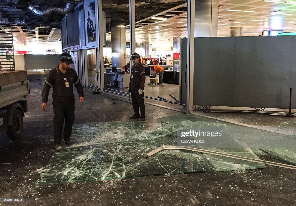 Authorized personnel clear glass debris in Ataturk airport's International arrival terminal on June 29, 2016, a day after a suicide bombing and gun attack targeted Istanbul's airport. A triple suicide bombing and gun attack that occurred on June 28, 2016 at Istanbul's Ataturk airport has killed at least 36 people, including foreigners, with Turkey's prime minister saying early signs pointed to an assault by the Islamic State group. / AFP / OZAN