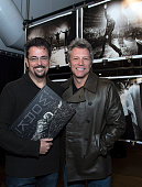 Author/Photographer David Bergman and musician Jon Bon Jovi attend the book signing for 'Work' at Altman Building on November 12 2014 in New York City