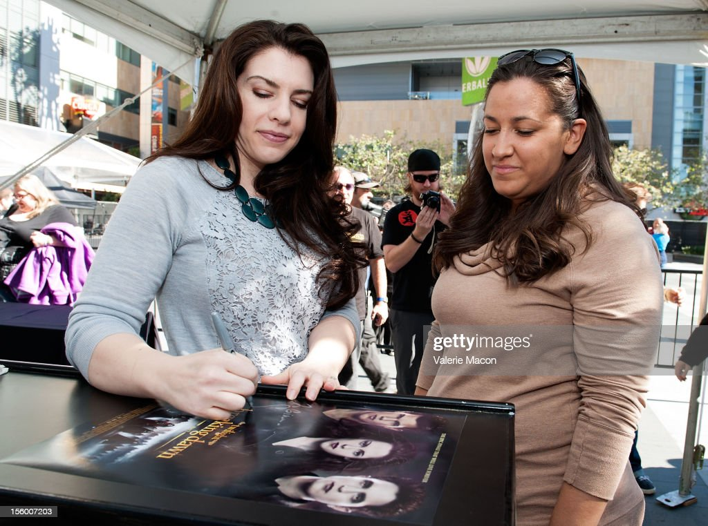 Author/producer Stephenie Meyer signs autographs at The Twilight Saga: Breaking Dawn Part 2' Fan Camp at L.A. LIVE on November 11, 2012 in Los Angeles, California.