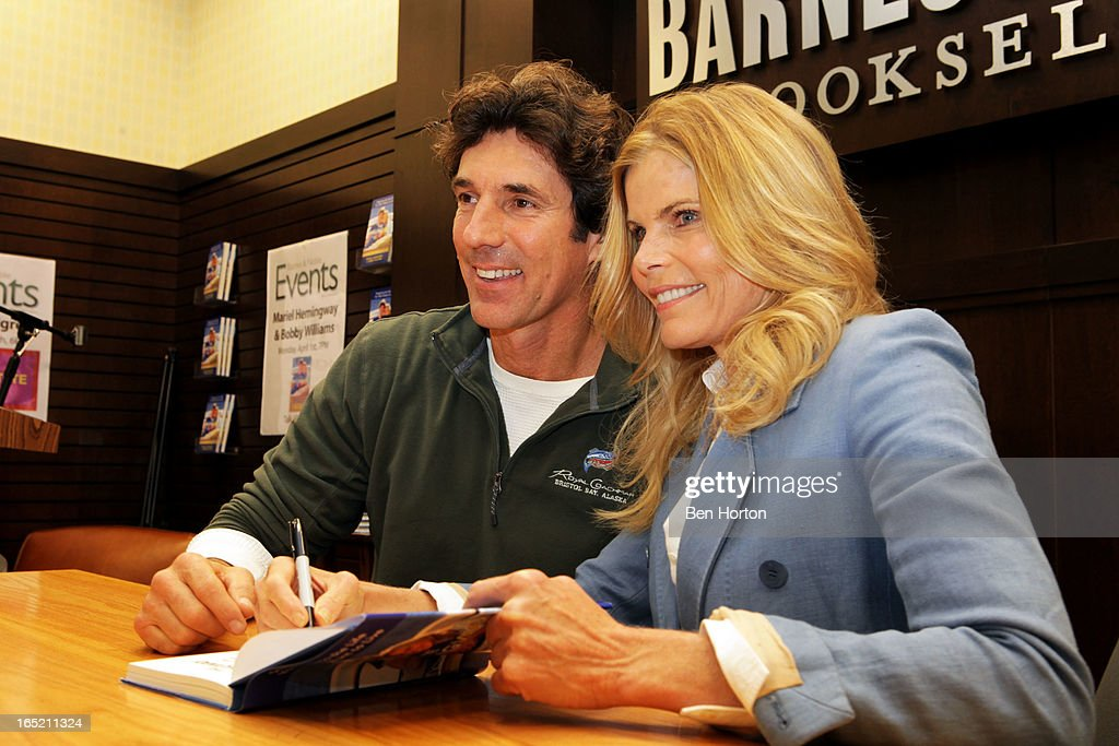 Authors Bobby Williams and <a gi-track='captionPersonalityLinkClicked' href=/galleries/search?phrase=Mariel+Hemingway&family=editorial&specificpeople=212955 ng-click='$event.stopPropagation()'>Mariel Hemingway</a> sign copies of their book 'The Willing Way' at Barnes & Noble bookstore at The Grove on April 1, 2013 in Los Angeles, California.