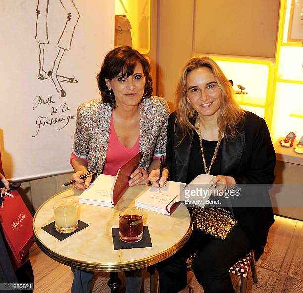 Authors Ines de la Fressange and Sophie Gachet sign copies of their book 'Parisian Chic A Style Guide by Ines de la Fressange' at the Roger Vivier...