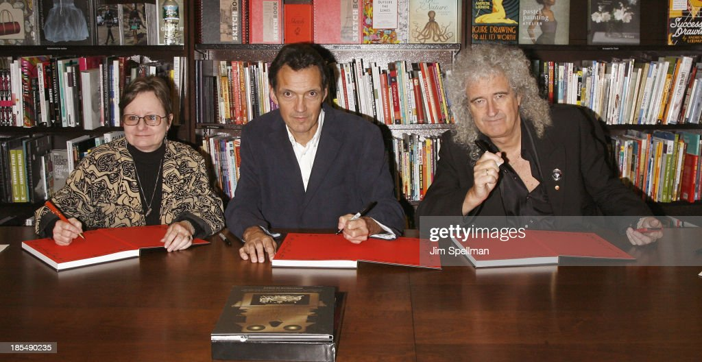 Authors Paula Fleming, Denis Pellerin and musician/singer/ songwriter/ author <a gi-track='captionPersonalityLinkClicked' href=/galleries/search?phrase=Brian+May&family=editorial&specificpeople=158059 ng-click='$event.stopPropagation()'>Brian May</a> sign copies of their book 'Diableries: Stereoscopic Adventures In Hell' at Barnes & Noble, 5th Avenue on October 21, 2013 in New York City.