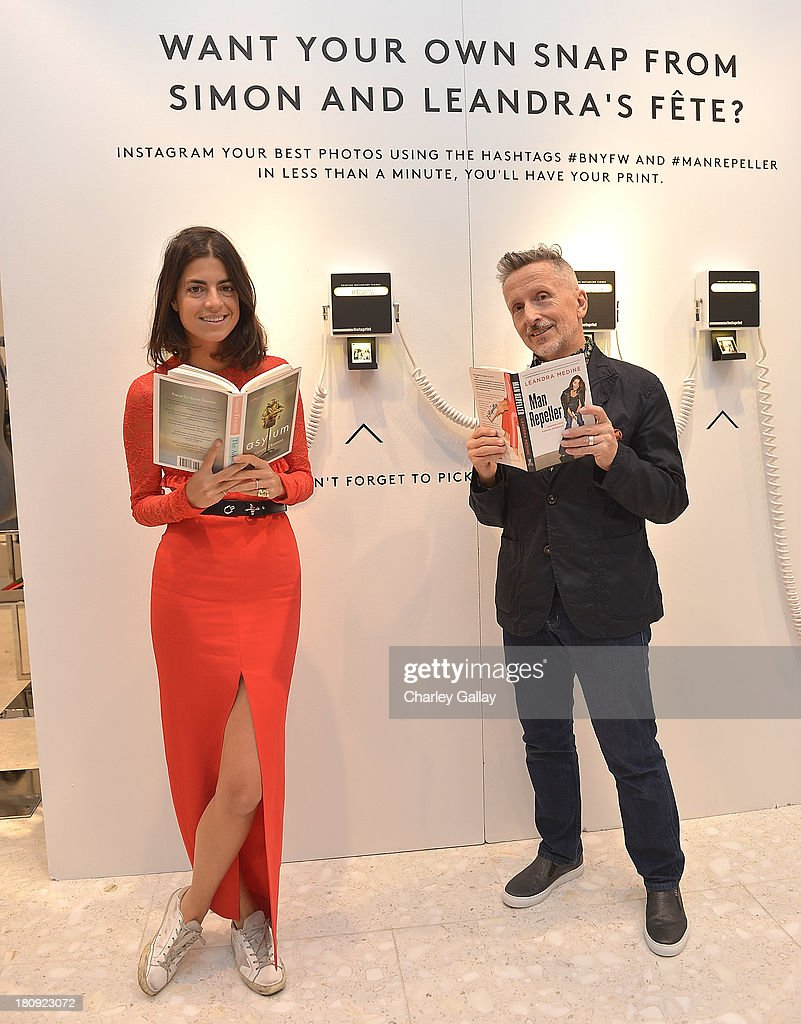 Authors Simon Doonan (R) and Leandra Medine attend Barneys New York Cocktail Event with Simon Doonan and 'Man Repeller' Leandra Medine celebrating their new books at Barneys New York At The Grove on September 17, 2013 in Los Angeles, California.