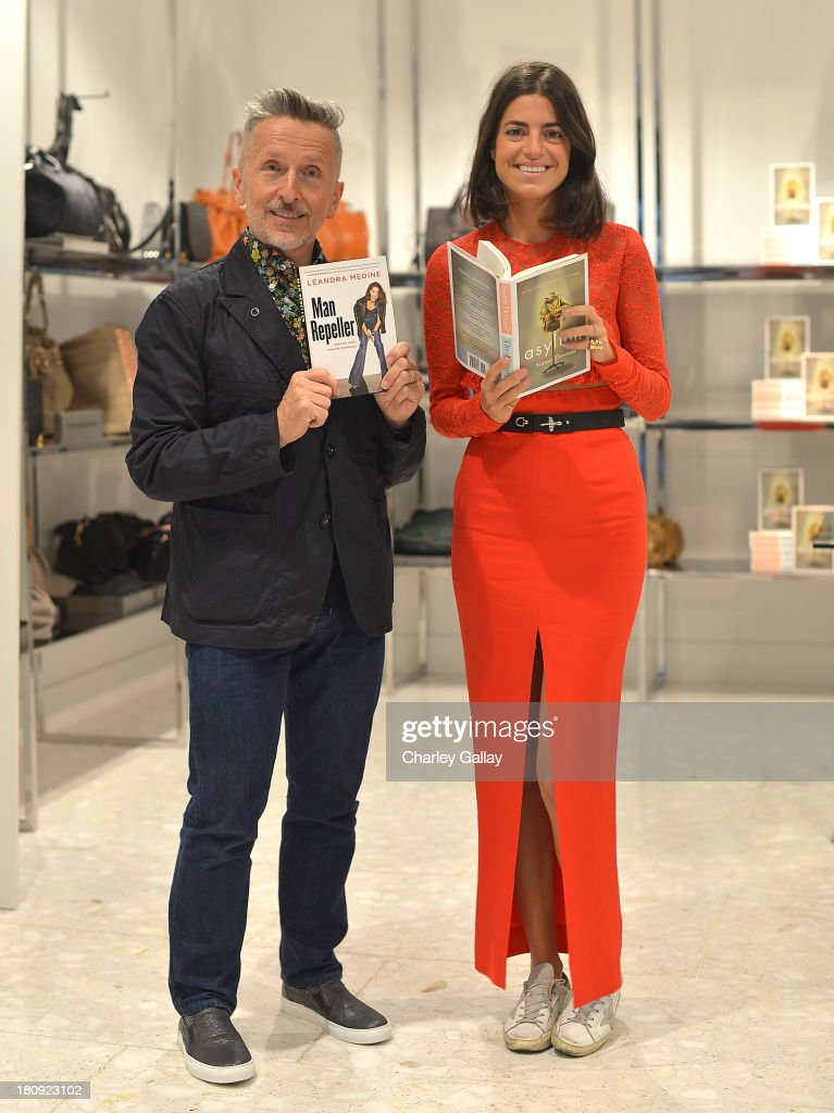 Authors Simon Doonan (L) and Leandra Medine attend Barneys New York Cocktail Event with Simon Doonan and 'Man Repeller' Leandra Medine celebrating their new books at Barneys New York At The Grove on September 17, 2013 in Los Angeles, California.