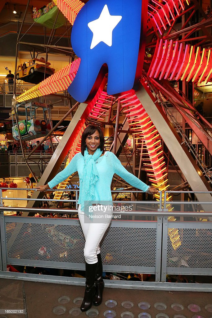 Autism Speaks board member, <a gi-track='captionPersonalityLinkClicked' href=/galleries/search?phrase=Holly+Robinson+Peete&family=editorial&specificpeople=213716 ng-click='$event.stopPropagation()'>Holly Robinson Peete</a> helps kick off the organization's Light it Up Blue campaign at Toys'R'Us Times Square on April 1, 2013 in New York City. The Light it Up Blue campaign asks people to shine a light on autism by illuminating, donating or advocating
