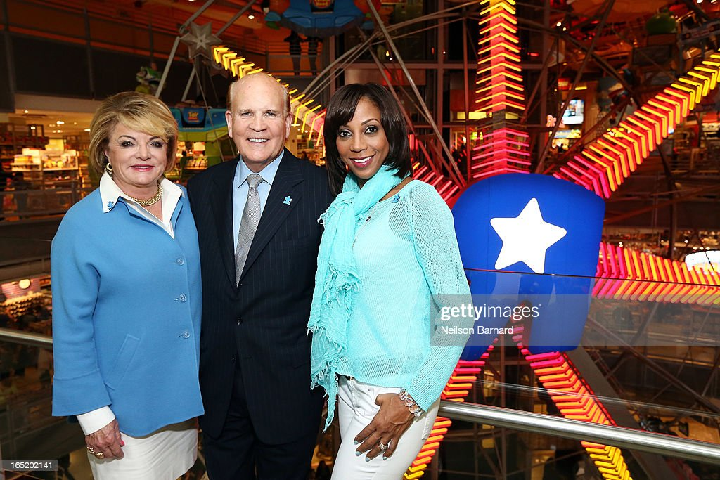 Autism Speaks Co-founders Suzanne Wright and Bob Wright and Autism Speaks board member Holly Robinson Peete help kick off the organization's Light it Up Blue campaign at Toys'R'Us Times Square on April 1, 2013 in New York City. The Light it Up Blue campaign asks people to shine a light on autism by illuminating, donating or advocating