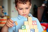 Autistic boy building with blocks