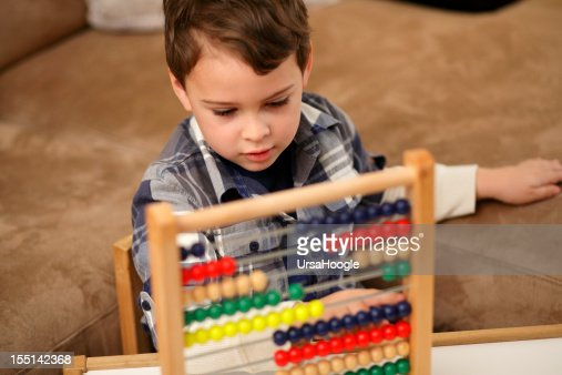 Musical Toys For Autistic Boys : Autistic boy counting on his abacus stock photo getty images