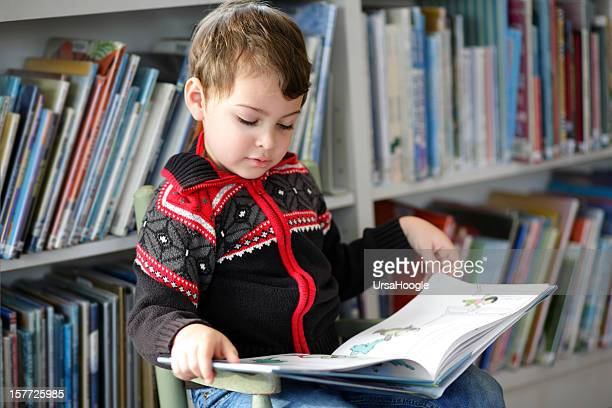 Autistic boy reading